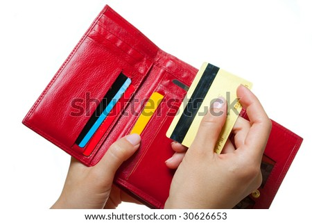 Hands with a purse and card