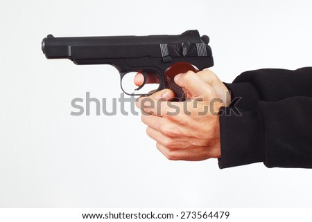 Hands with automatic pistol on a white background