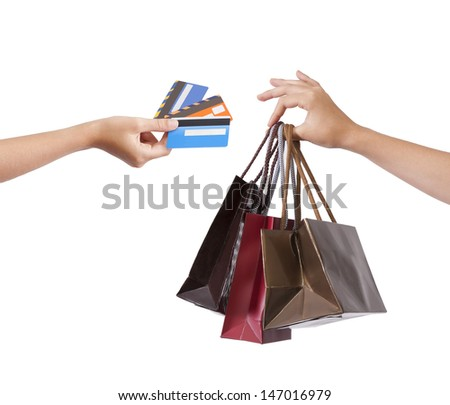 hands with bags and credit cards