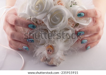 hands with beautiful nails holds a wedding bouquet of flowers