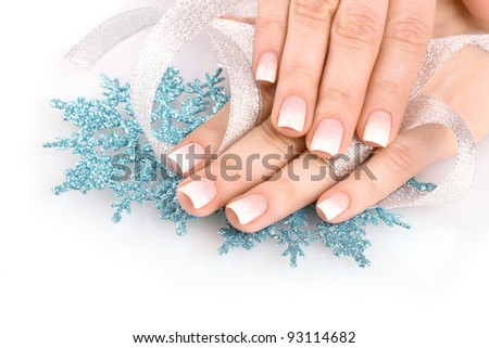 hands with beautiful winter design, snowflakes and ribbon solated on white - stock photo