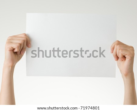 hands with blank paper - stock photo