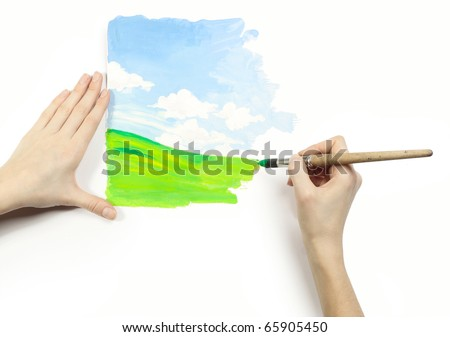 Hands with brush and fresh drawing on a white background - stock photo