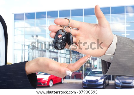 Hands with car keys. Dealer and client. - stock photo