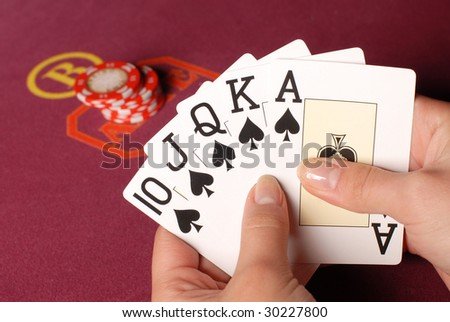 Hands with cards in a casino