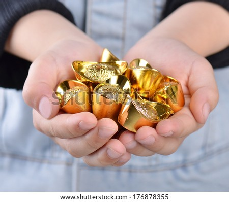 Hands with chinese gold - stock photo