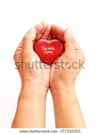 hands with chocolate heart isolated on white background, love concept.