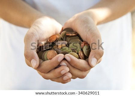 hands with coins saving concept - stock photo
