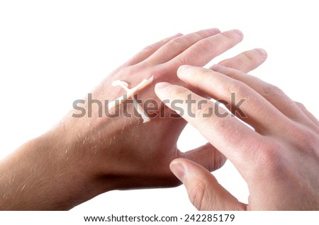 hands with cross-shaped cream meaning the need of the regeneration - stock photo