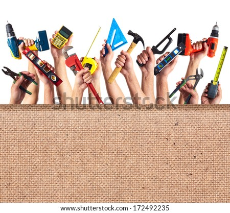 Hands with DIY tools. Construction renovation collage background. - stock photo