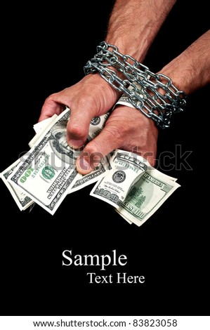 Hands with dollars in chain on a black background - stock photo