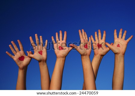 Hands with drawn hearts on them - stock photo