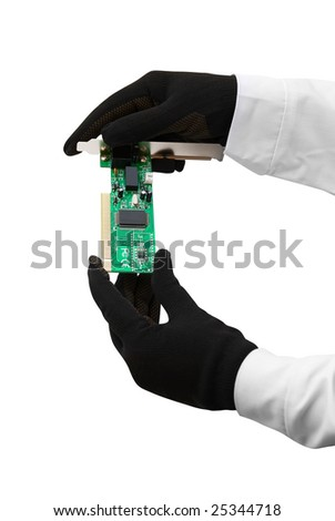 Hands with gloves hold chip on white - stock photo