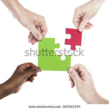 Hands with jigsaw isolated on white - stock photo