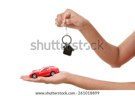 Hands with keys and car isolated on white background - stock photo