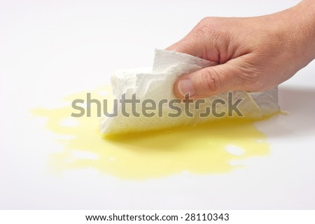 Hands with kitchen paper wiping up spilled fluid - stock photo