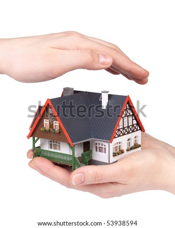 Hands with model of house on a white background. Concept  of buying and insuring  real estate.