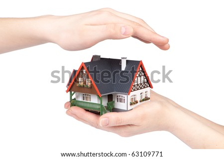Hands with model of house on a white background. Concept  of buying and insuring  real estate. - stock photo