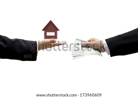 Hands with money and house as business abstract.  House Loan concept - stock photo