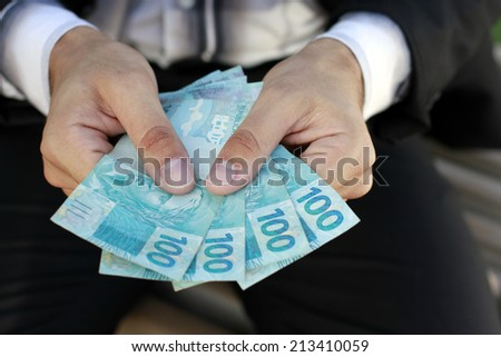 hands with money real - stock photo
