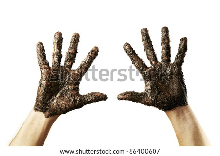 Hands with mud on white - stock photo