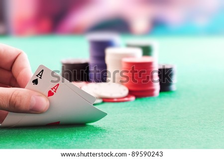 hands with pair of aces - stock photo