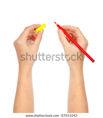 hands with pencil and eraser - stock photo