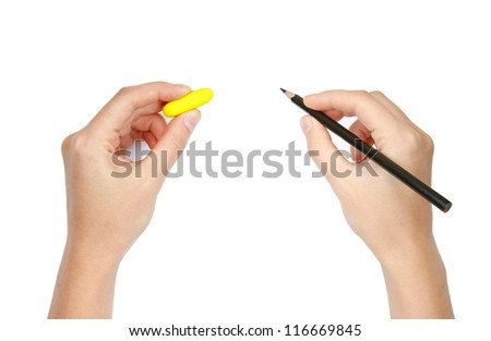 hands with pencil and eraser with space for text - stock photo