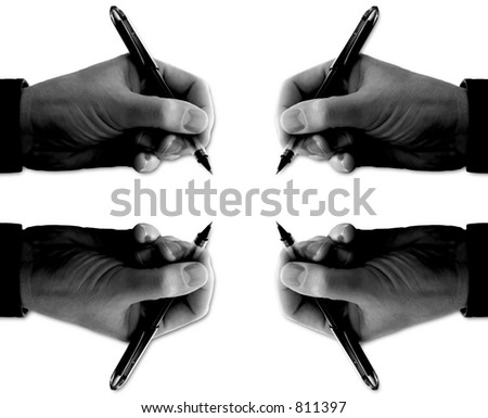 Hands with pens  - represents mountain of paperwork or needing signatures from every direction. - stock photo