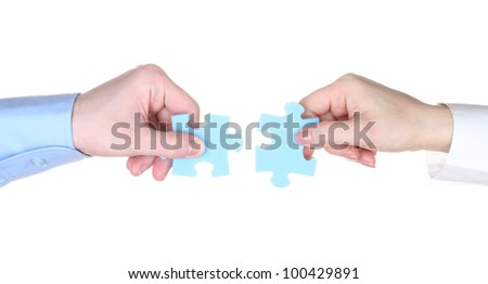 Hands with puzzle isolated on white - stock photo