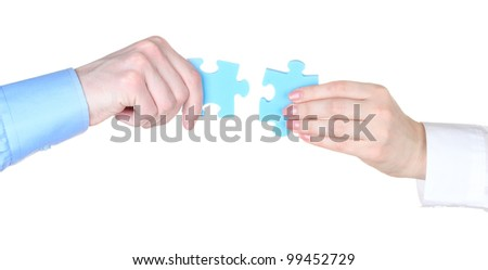 Hands with puzzle isolated on white