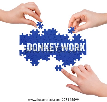 Hands with puzzle making DONKEY WORK word  isolated on white  - stock photo