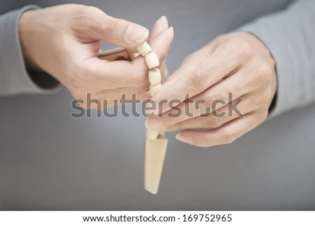 Hands with rosary beads. Close-up view - stock photo