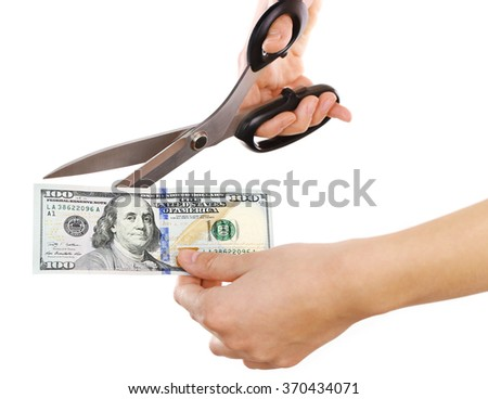 Hands with scissors cutting dollar banknote, isolated on white - stock photo