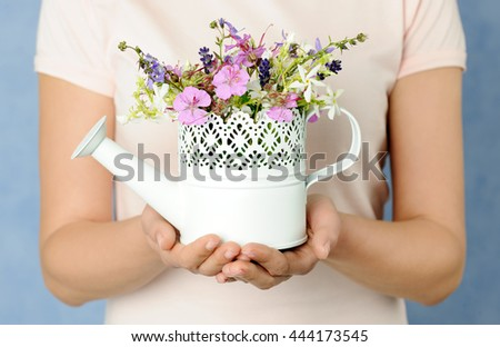 hands with small summer bouquet - stock photo