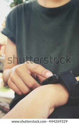 Hands with smartwatch