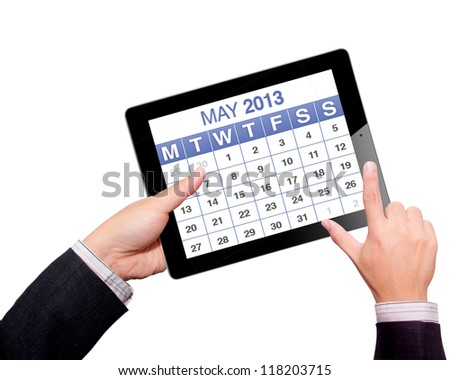 Hands with tablet computer calendar 2013. Isolated on white background. - stock photo