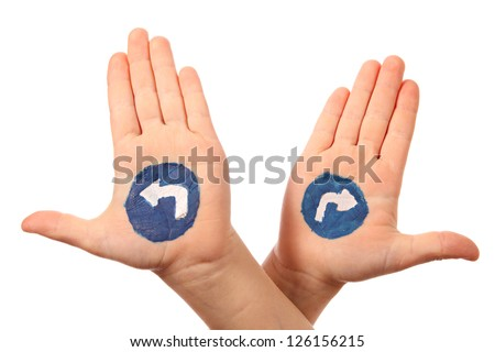 Hands with the drawn traffic signs as a designator of directing - stock photo