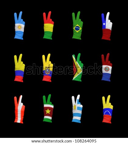 Hands with victory gesture in gloves decorated with south american flags