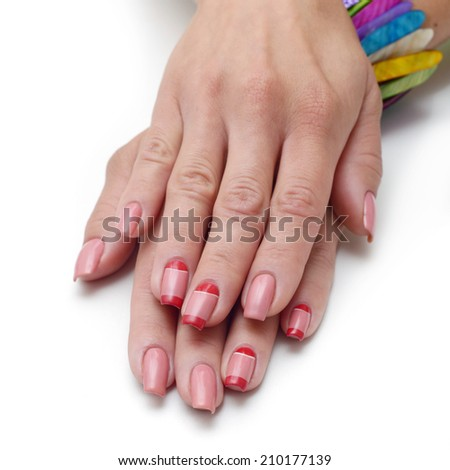 hands with woman's professional pink nails manicure isolated  - stock photo