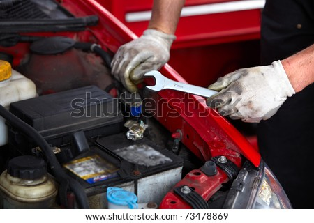 Hands with wrench. Mechanic. Auto repair shop. - stock photo