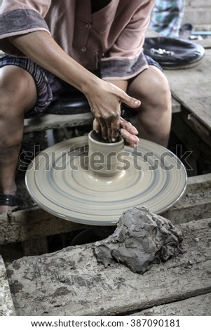 Hands work on clay pottery wheel , earthenware , ceramic, Traditional Koh Kret Thailand. - stock photo