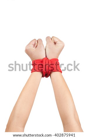 hands wrapped with rope around wrists in captivity , victim abused , missing kidnapped , slave of work , respect for human rights and exploitation concept isolated on black background - stock photo