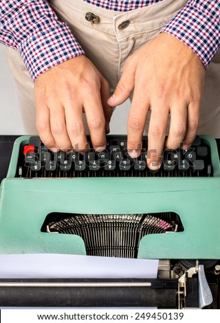 Hands writing a typewriter - stock photo