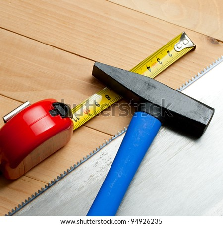 Handsaw, tape measure and hammer