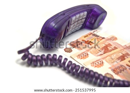 Handset and money on white background - stock photo
