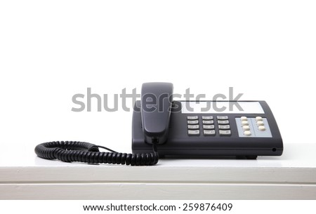 Handset in office room white background - stock photo