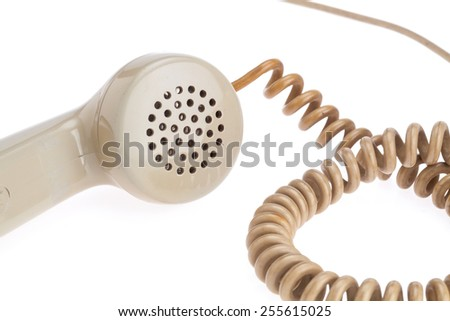 handset of antique telephone placed on isolate white background. Closed up on microphone - stock photo