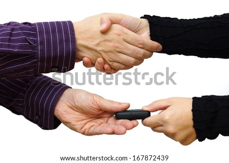 Handshake after buying a car and exchange keys - stock photo
