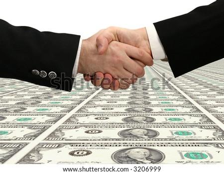 Handshake and American dollars - stock photo